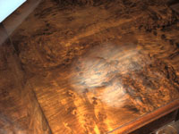 "White hazing - ""heat blush"" - on an expensive burl walnut table"